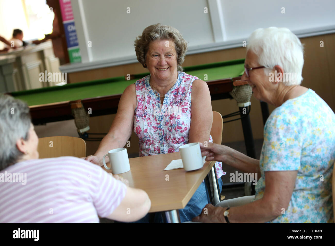 Older women kissing women