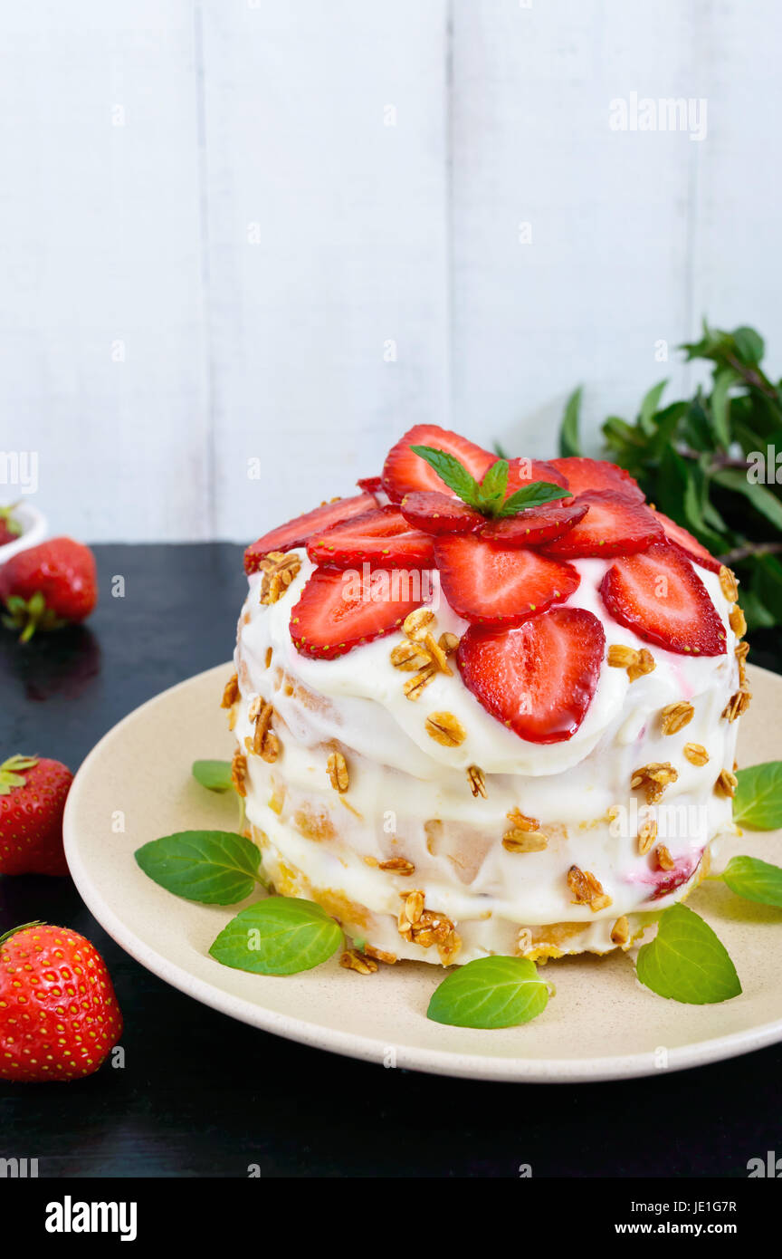 A Festive Cake With Fresh Strawberries Cream Decorated With Mint