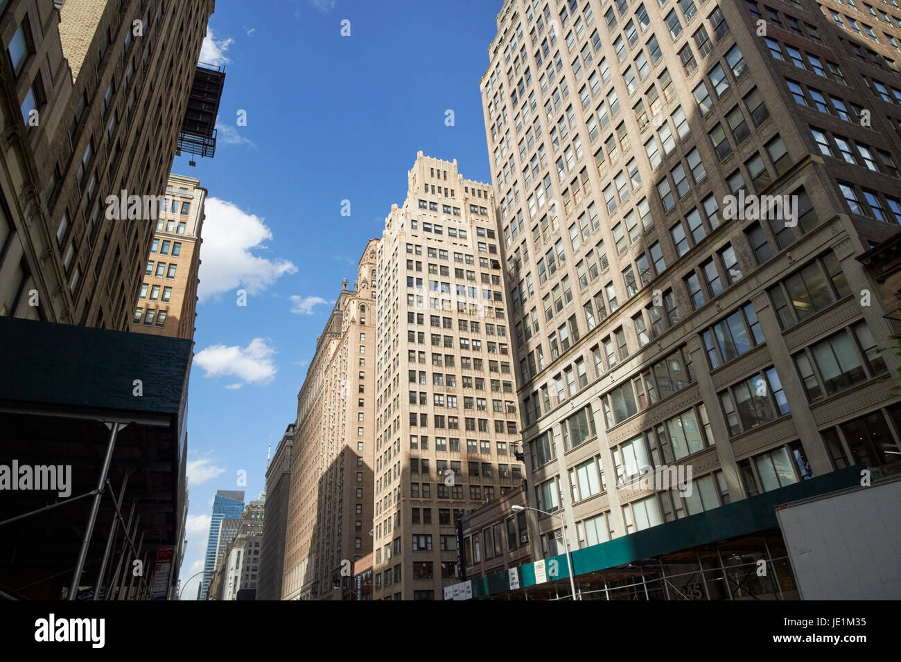 1920s office buildings looking up seventh avenue midtown New York City USA - Stock Image