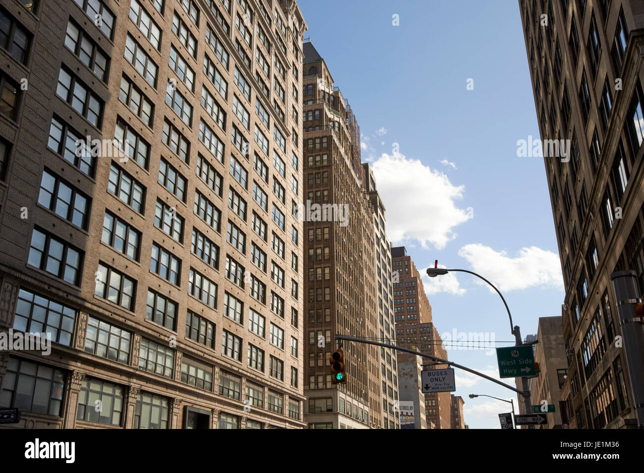 1920s office buildings looking down seventh avenue midtown New York City USA - Stock Image