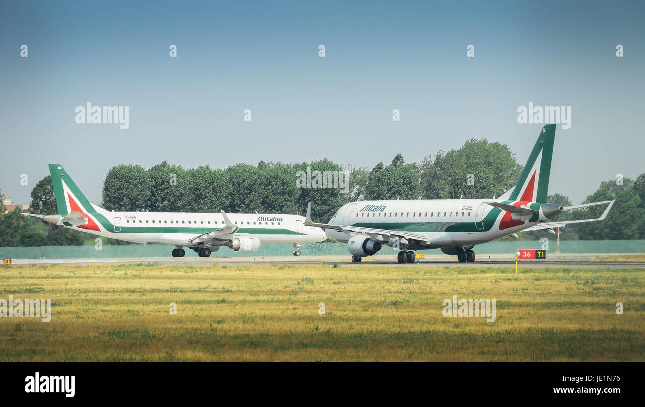 Alitalia airplane at Milan's Linate airport on a sunny day - Stock Image