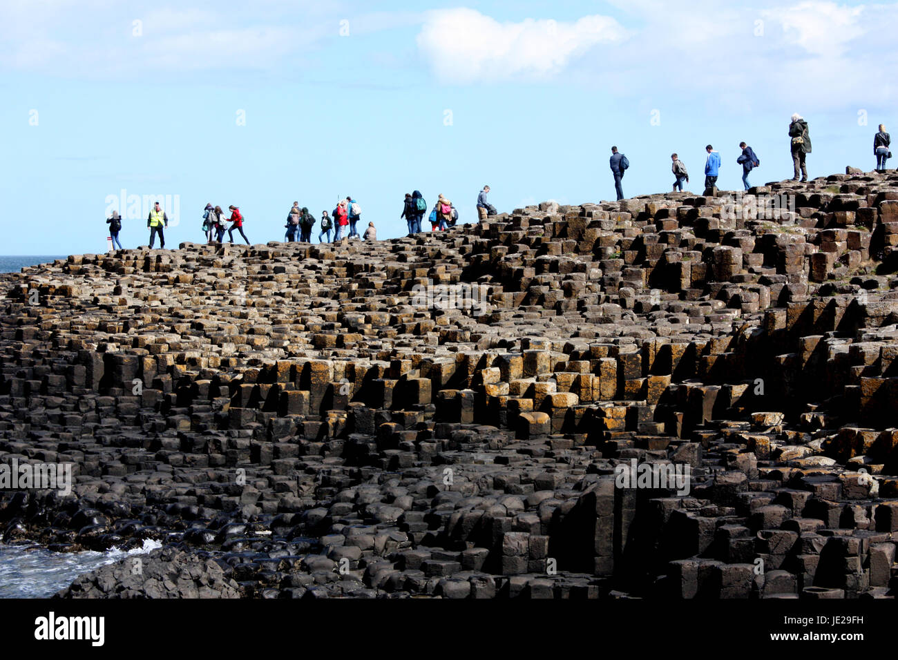 People on the Giant's Causeway, Antrim - Stock Image