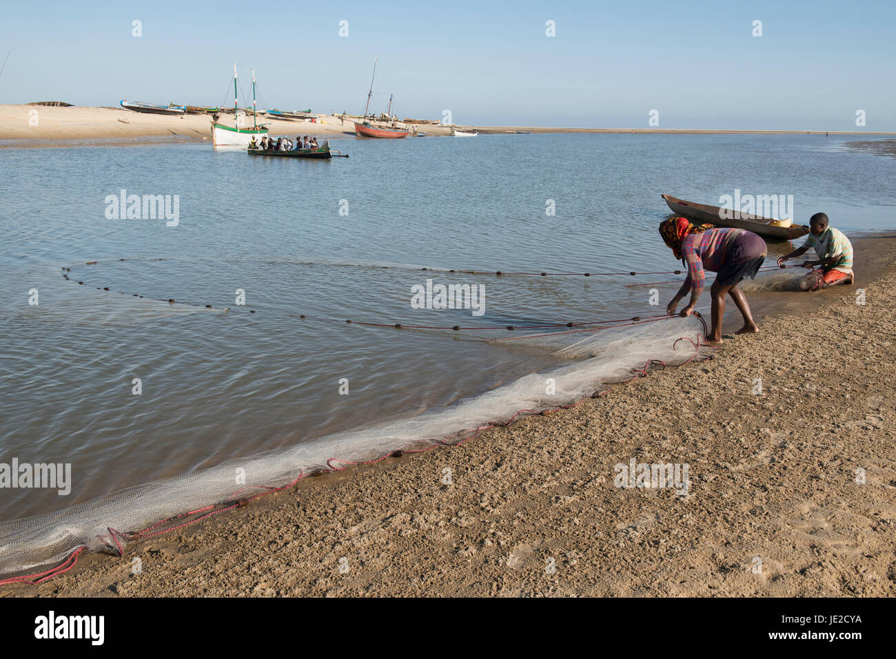 Malagasy couple working their fish nets, Morondava, Madagascar - Stock Image
