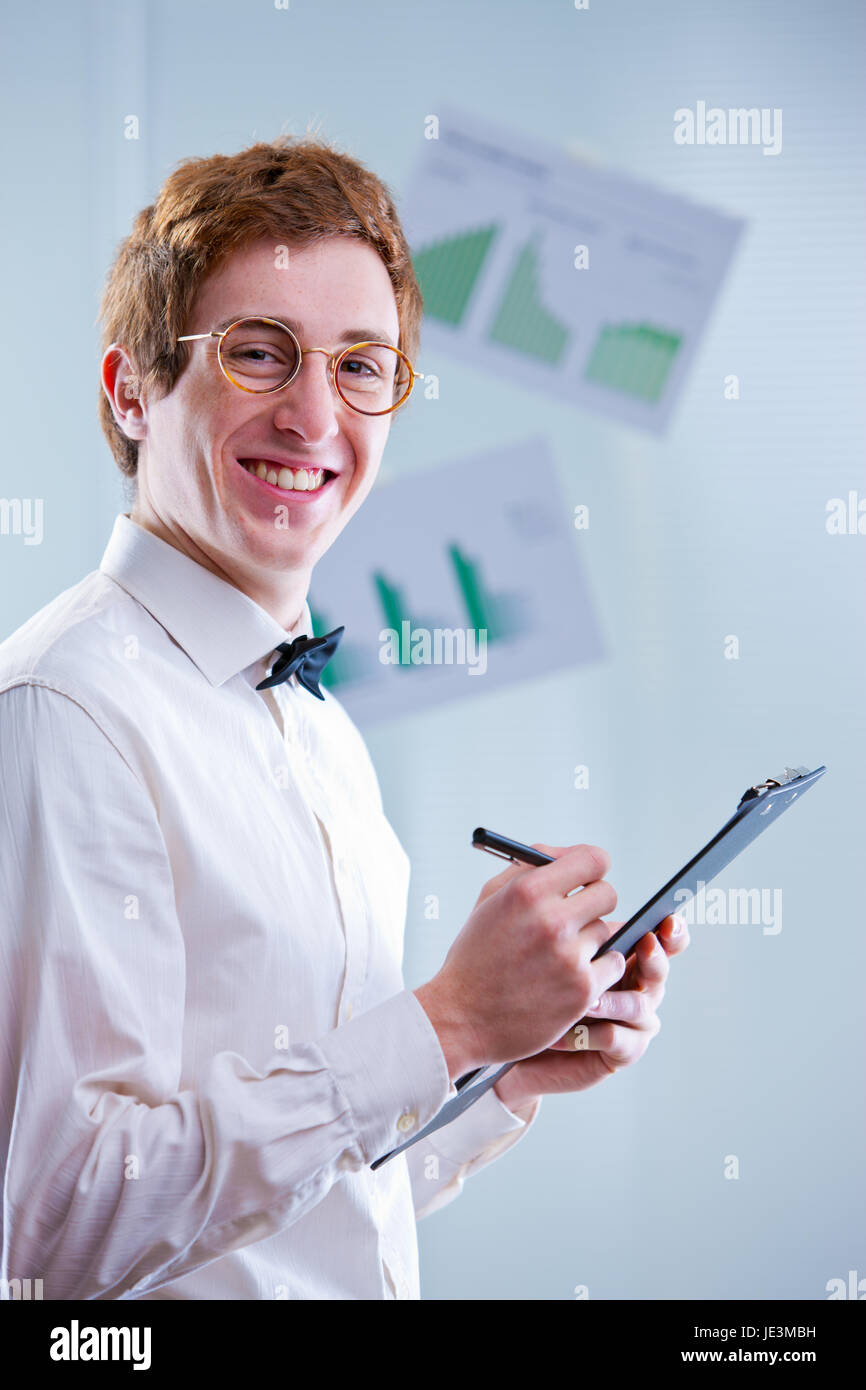 a redheaded accountant with glasses sayin that accounting means funny numbers always squaring - Stock Image