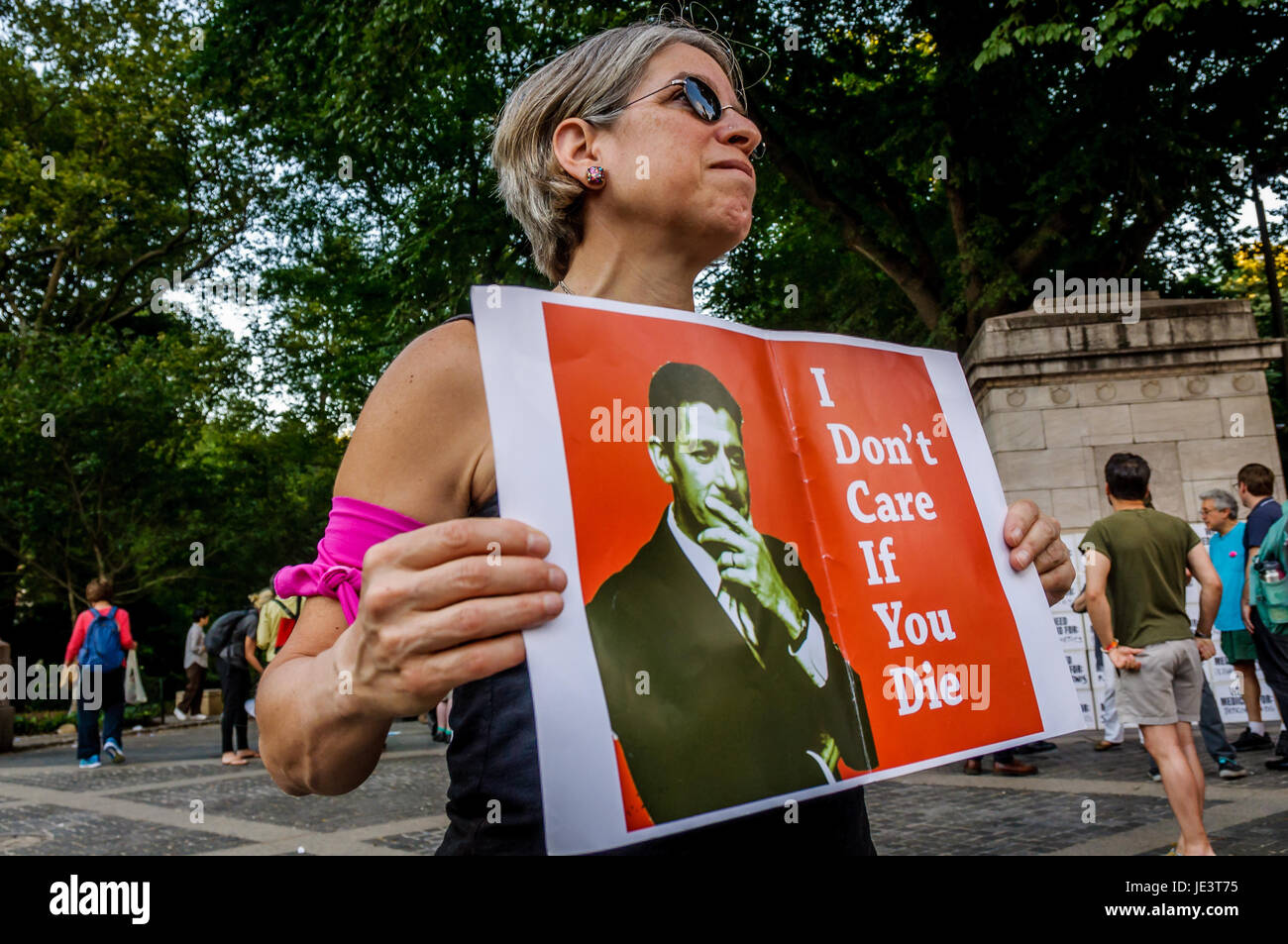 New York, United States. 21st June, 2017. NYC healthcare and resistance activists and allies organized a round-the Stock Photo
