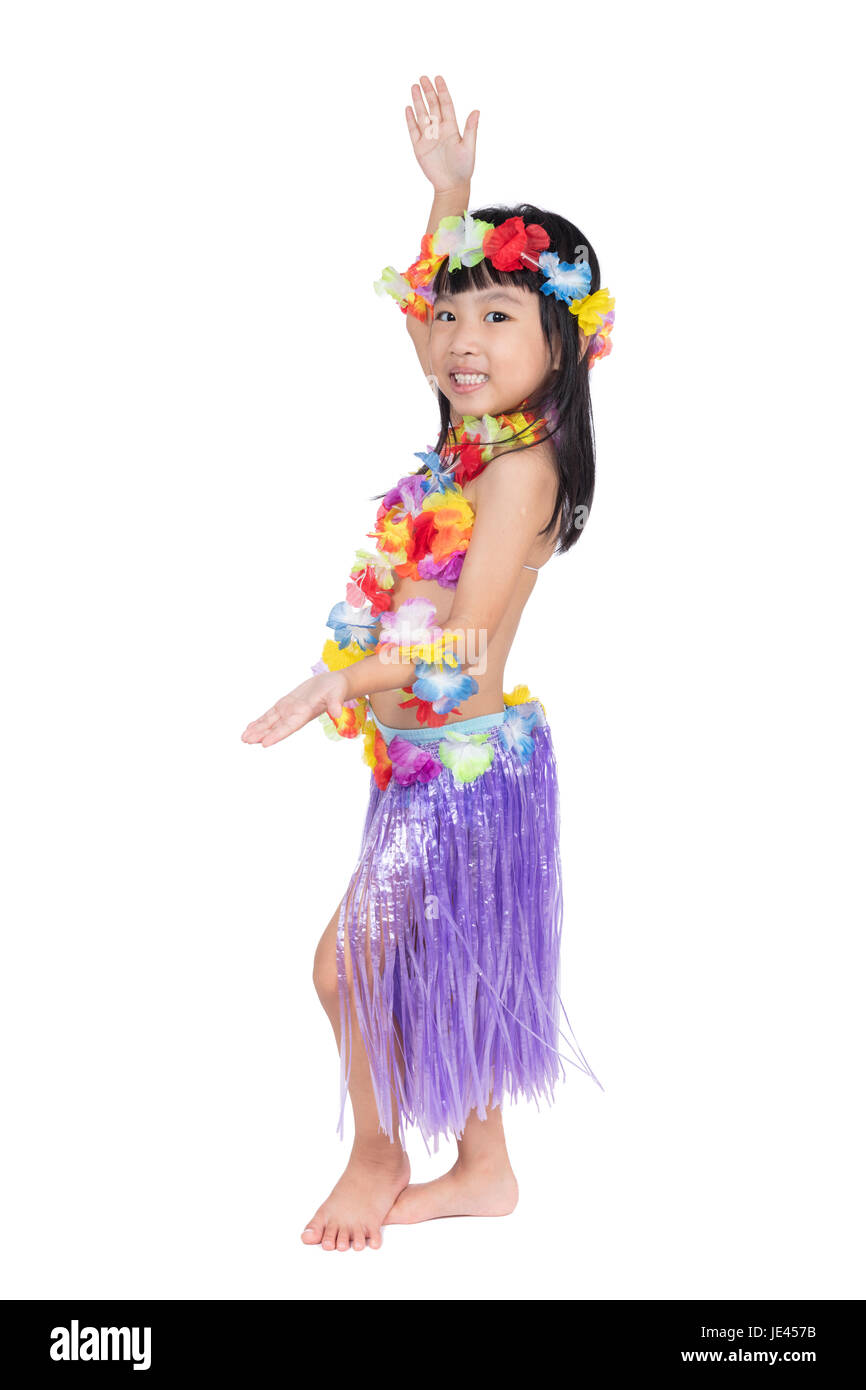 Asian Chinese little girl in hawaiian costume pretending to be a Hula Dancer in isolated white background - Stock Image