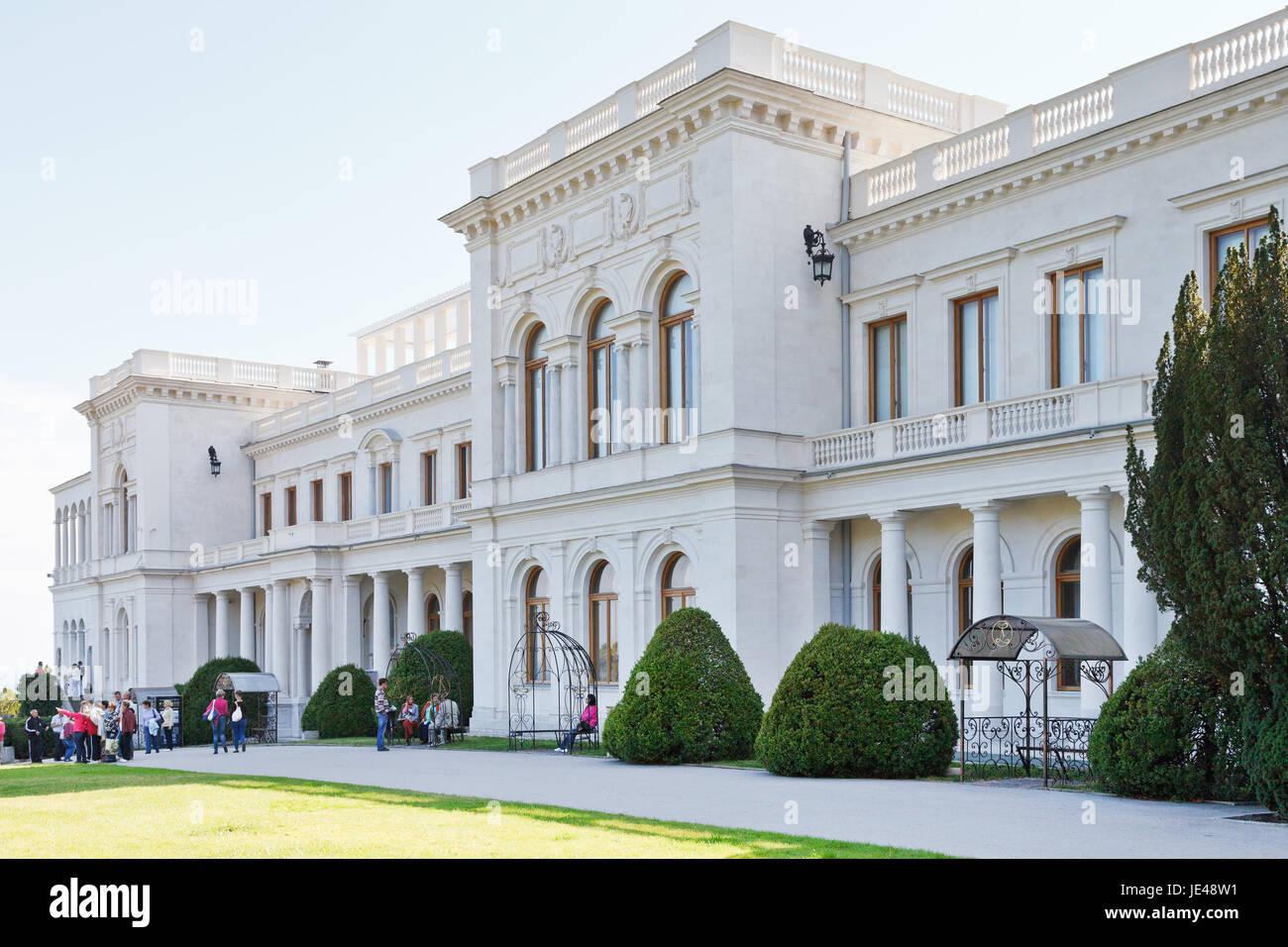 YALTA, RUSSIA - SEPTEMBER 28, 2014: tourists near Grand Livadia Palace in Crimea. Livadia estate was summer residence - Stock Image