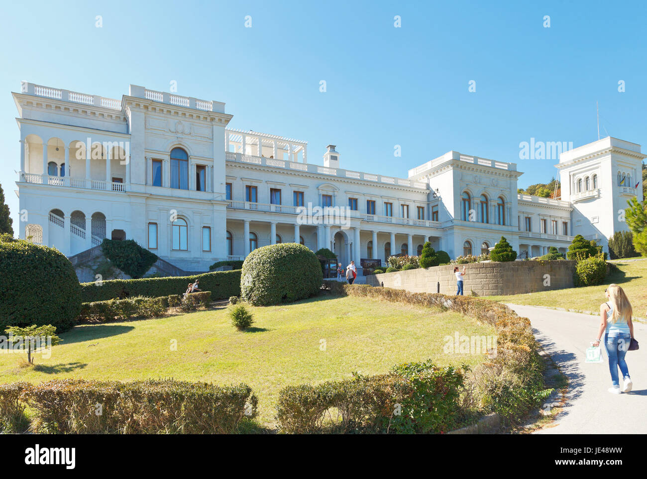 YALTA, RUSSIA - SEPTEMBER 30, 2014: people walking in park of Grand Livadia Palace in Crimea. Livadia estate was - Stock Image