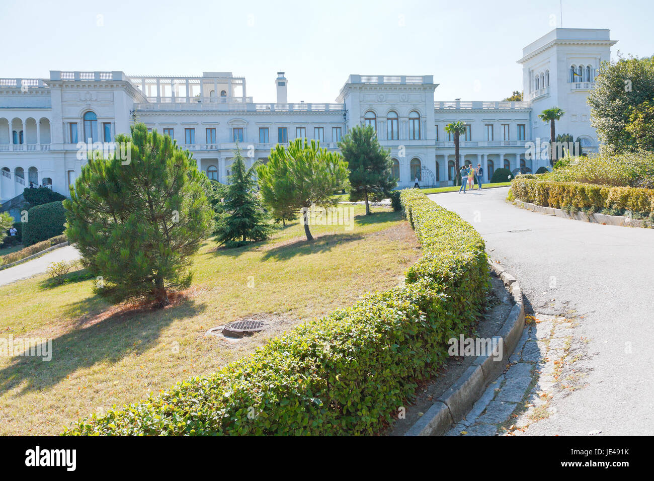 YALTA, RUSSIA - SEPTEMBER 28, 2014: people in park of Grand Livadia Palace in Crimea. Livadia estate was summer - Stock Image