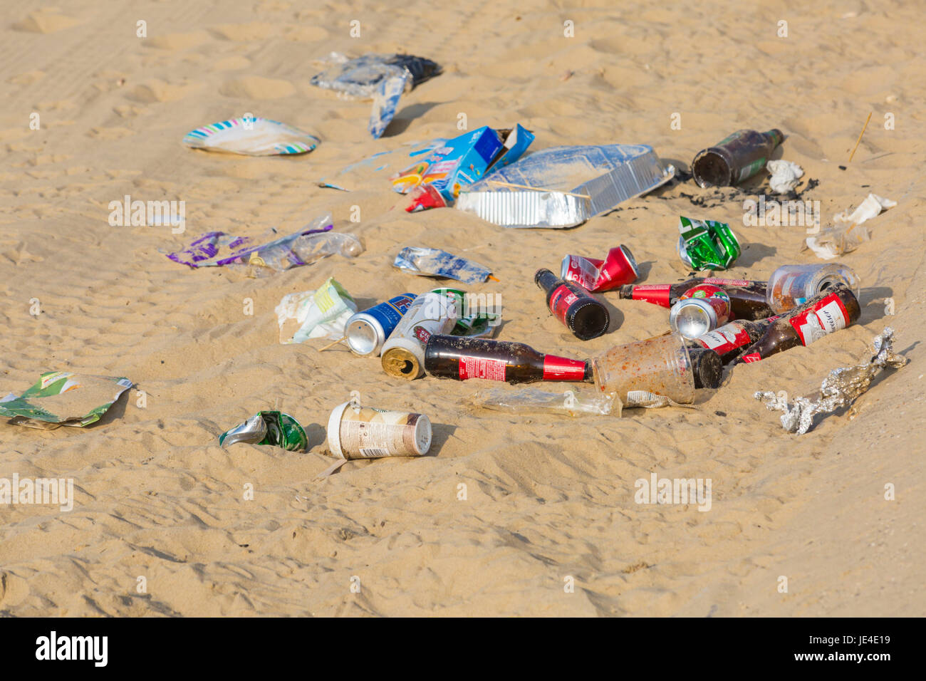 Litter rubbish left behind on the beach at Bournemouth beach, Bournemouth, Dorset UK  in June - Stock Image