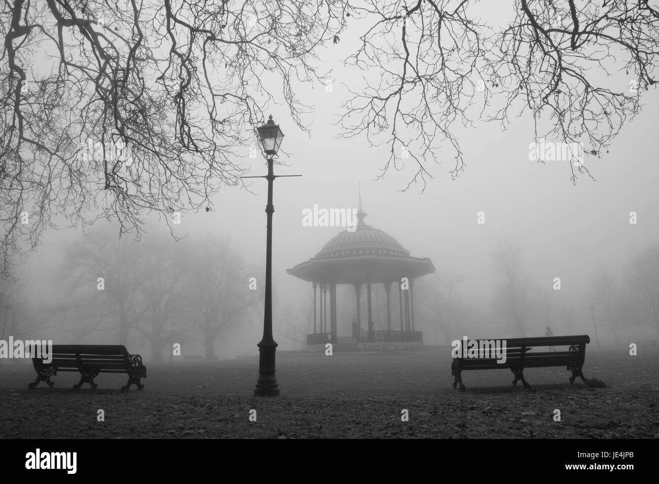 Freezing fog by the bandstand on Clapham Common, Clapham, London, UK - Stock Image