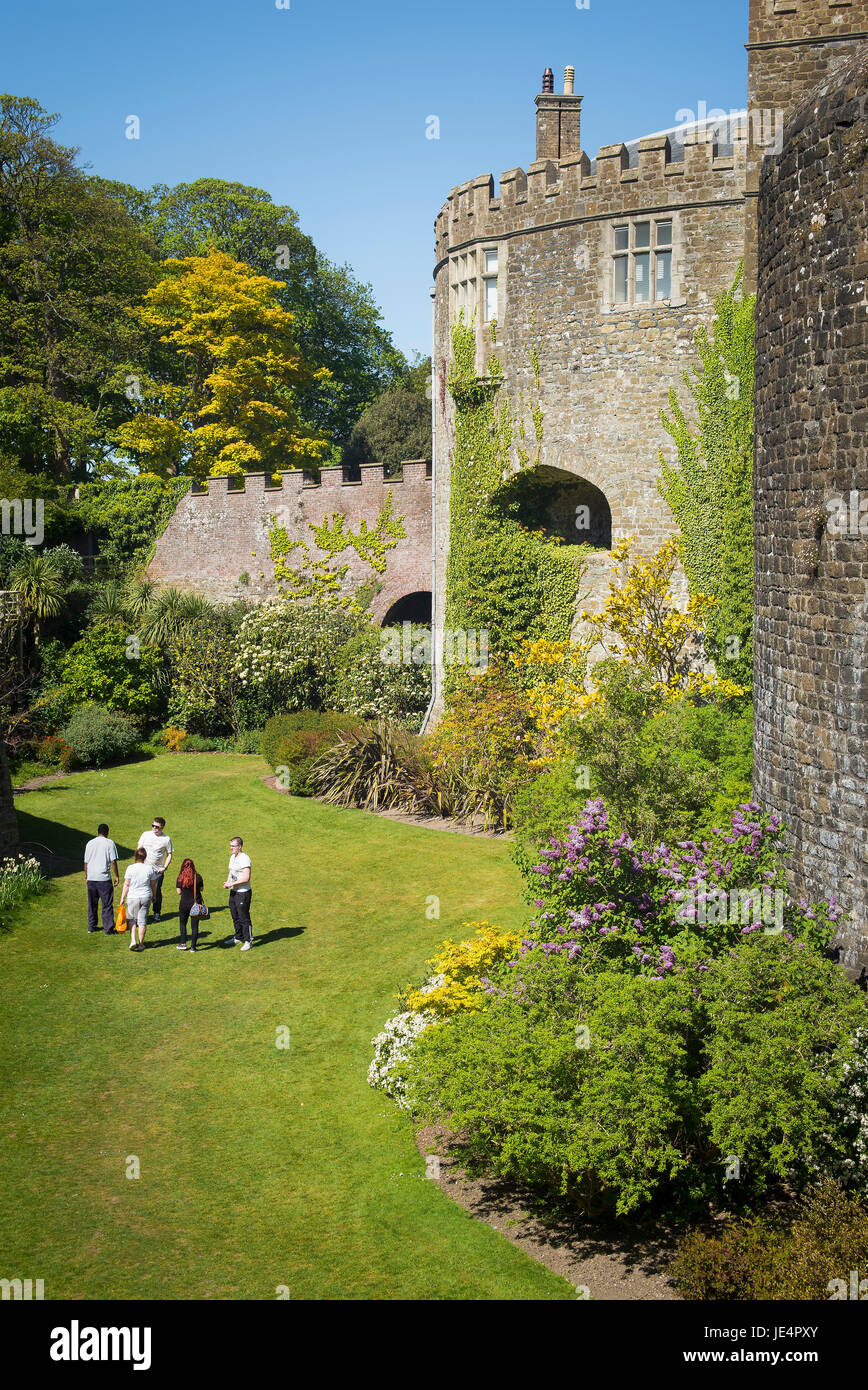 Visitors walking in the grassed moat at Walmer Castle Deal Kent UK - Stock Image