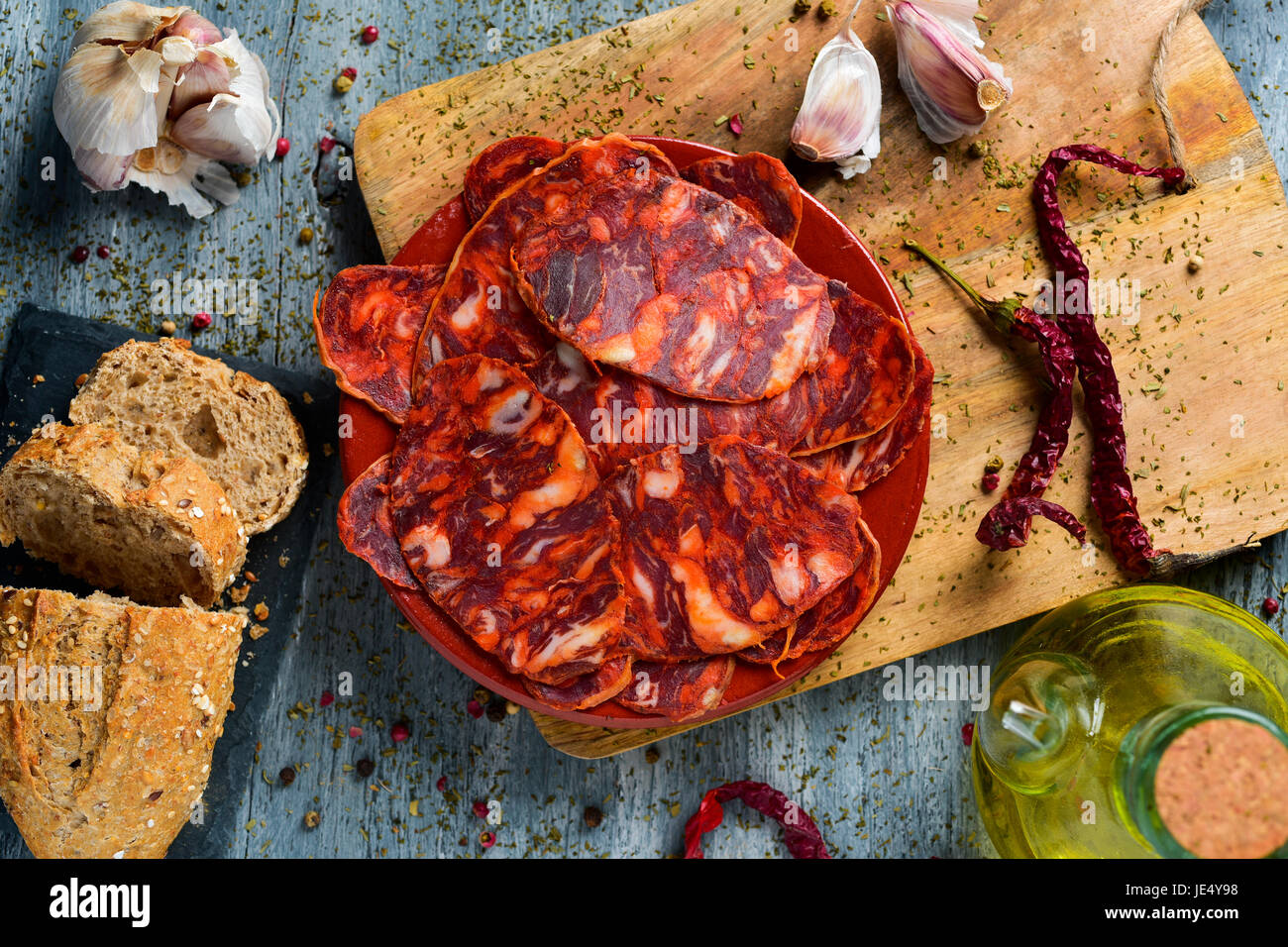 high-angle shot of an earthenware plate with some slices of spanish chorizo, cured pork sausage, some slices of - Stock Image