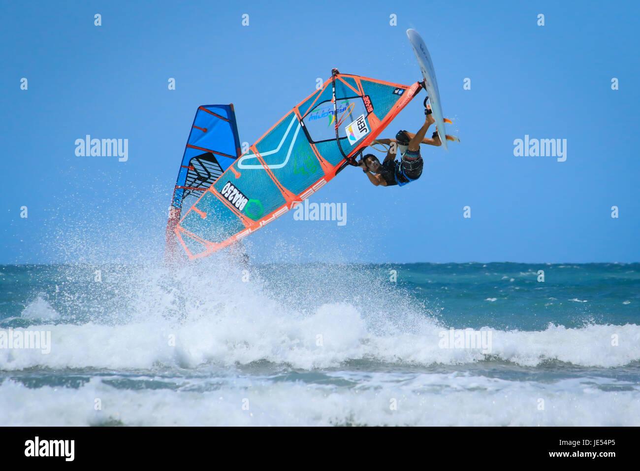 JERICOACOARA.CEARA/BRASIL - CIRCA DECEMBER 2016: windsurfer sportmen Advan Souza makes trick at the water jumpimg - Stock Image