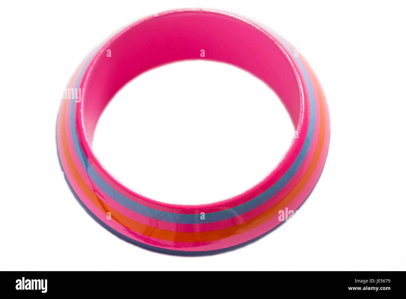 Pink bangle with orange and blue stripes isolated on white background - Stock Image
