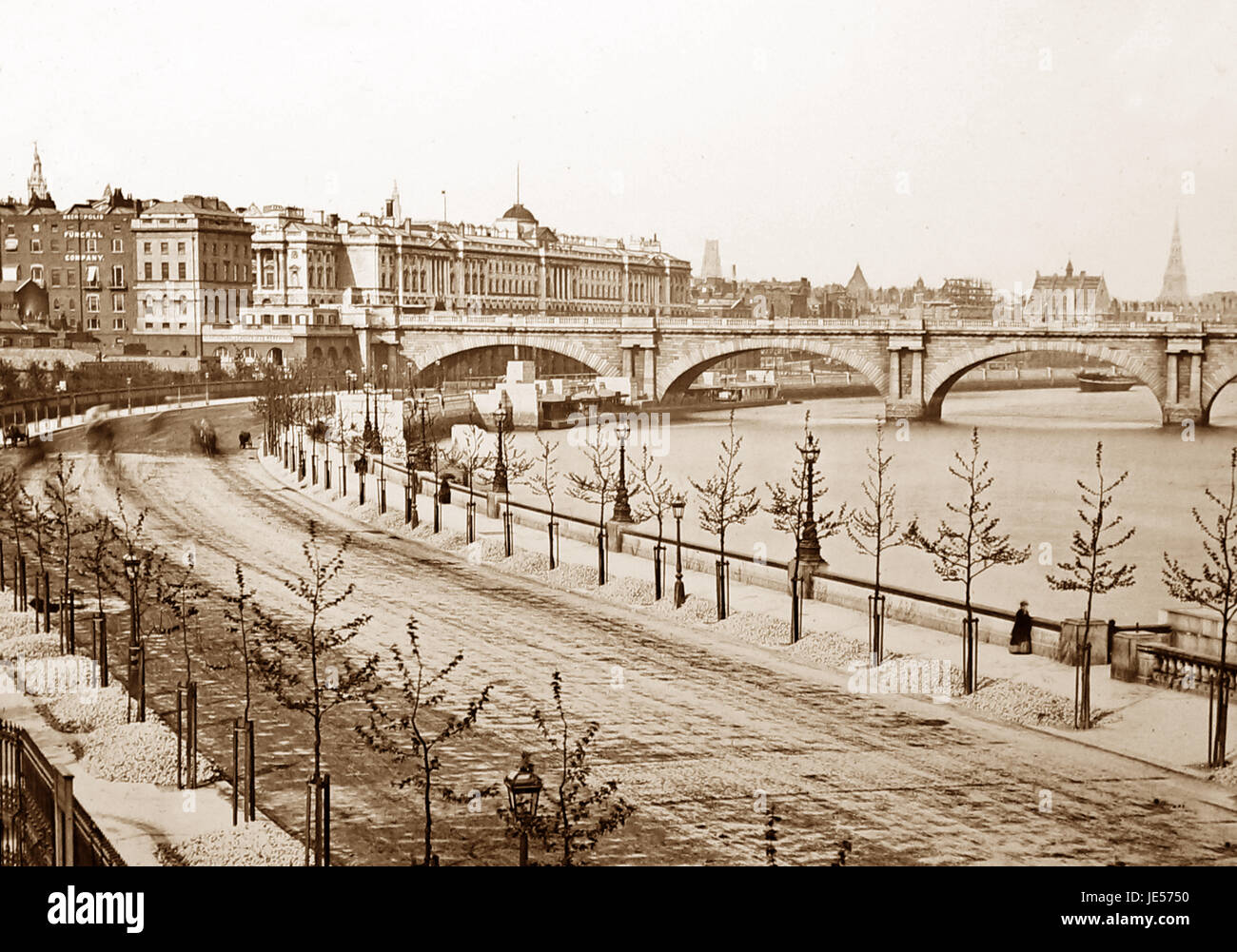 London Embankment in the snow, Victorian period - Stock Image