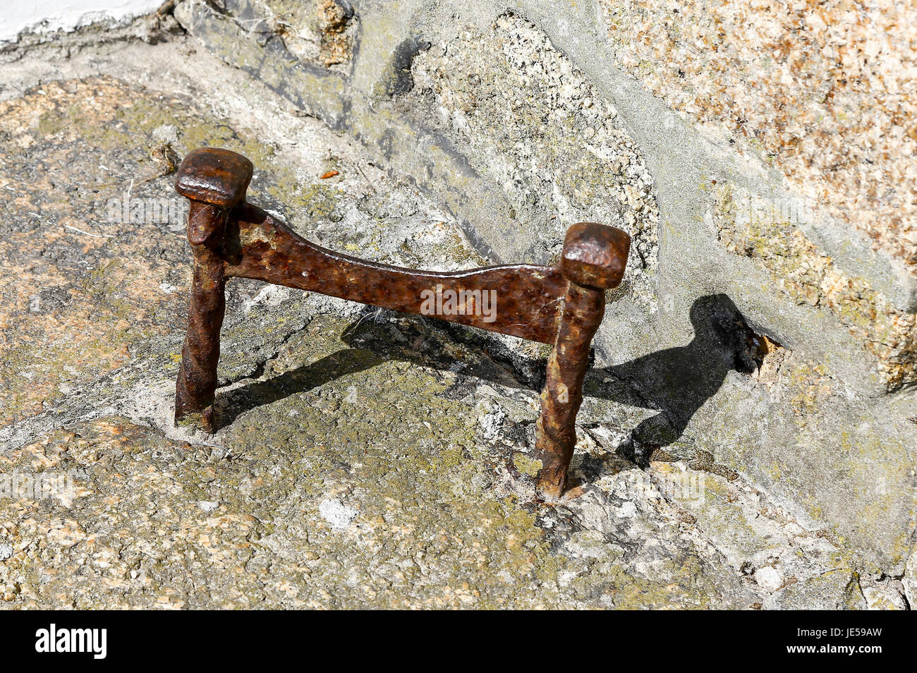 An old rusty cast iron boot scraper - Stock Image