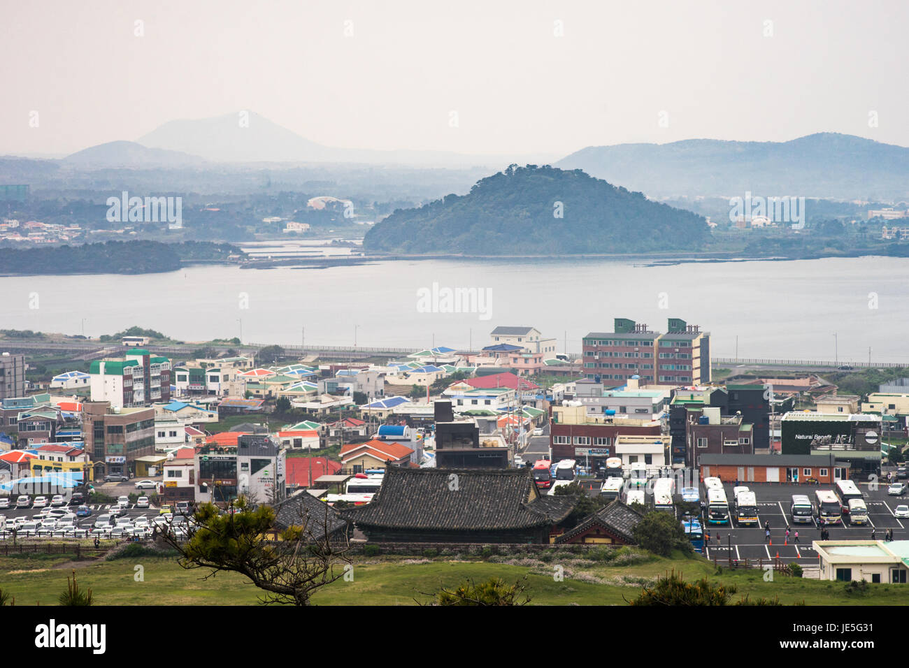 The view on a grey day from Seongsan Ilchulbong looking back onto the main Jeju island. - Stock Image