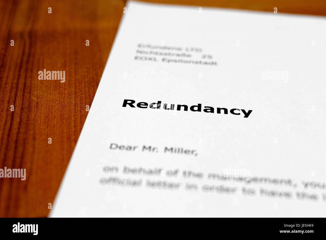 A letter on a wooden table - redundancy - Stock Image