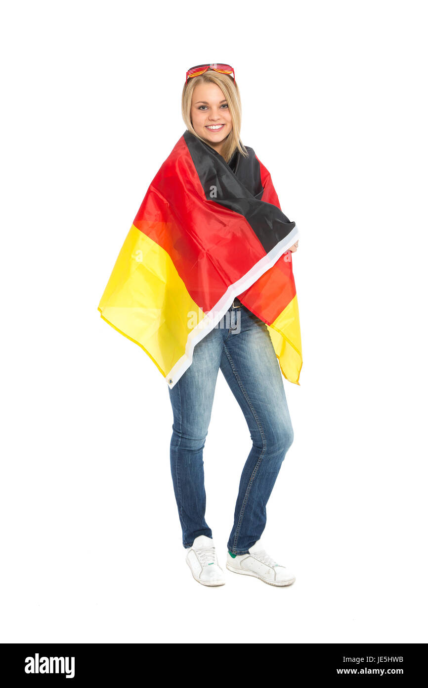 woman wraps herself in germany banner - Stock Image