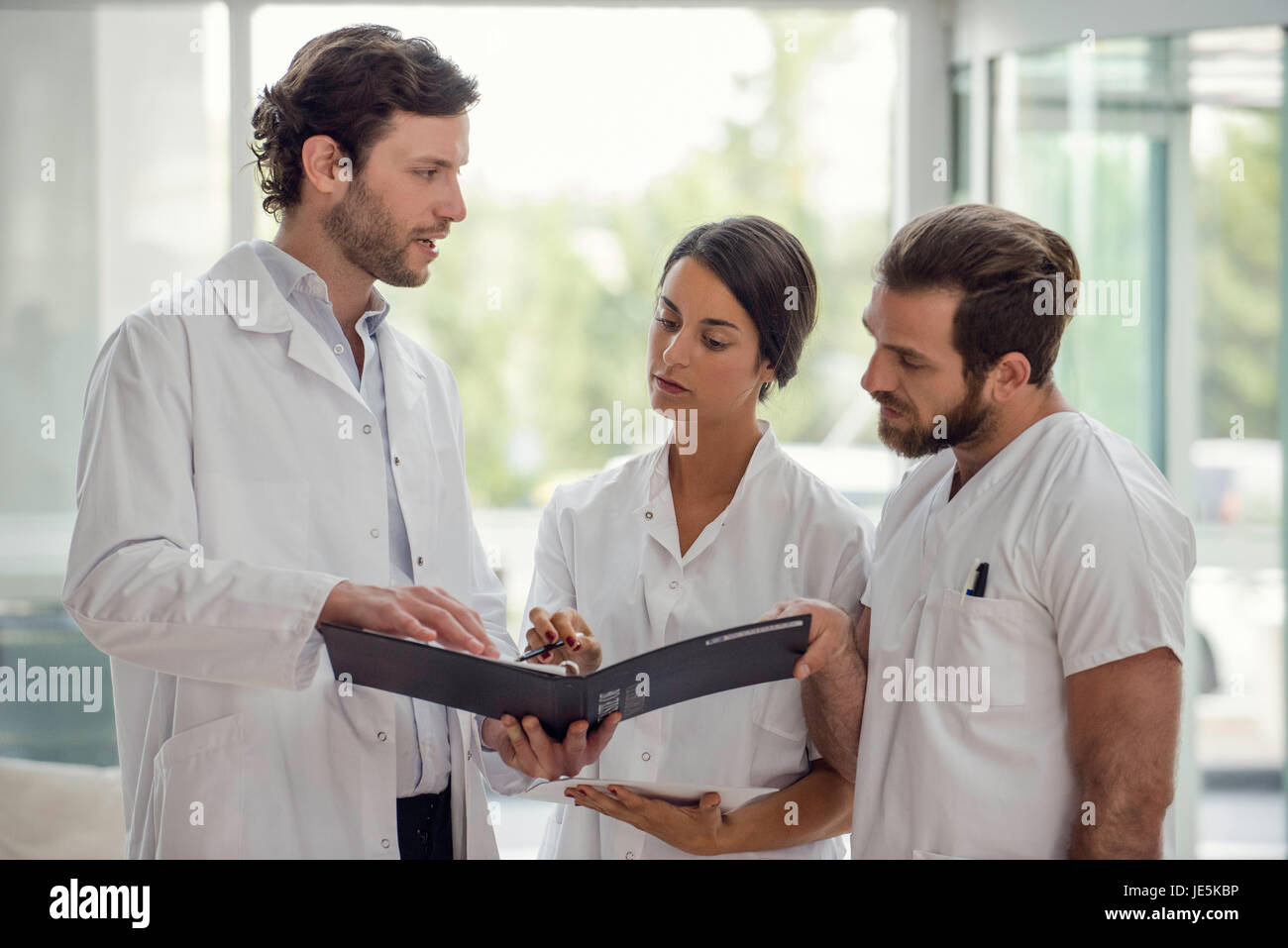 Healthcare professionals working together - Stock Image