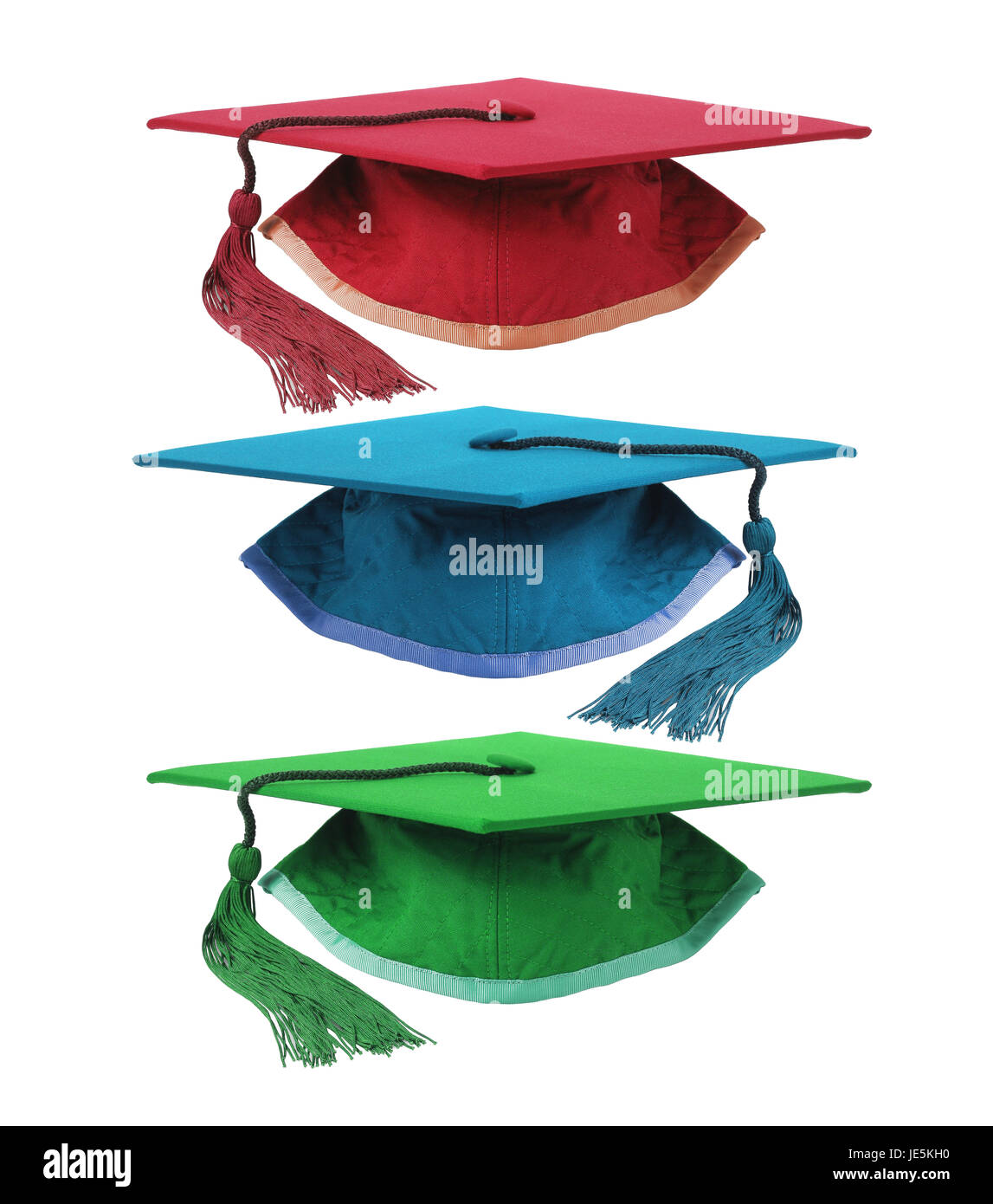 Three Colourful Graduation Mortar Boards on White Background - Stock Image