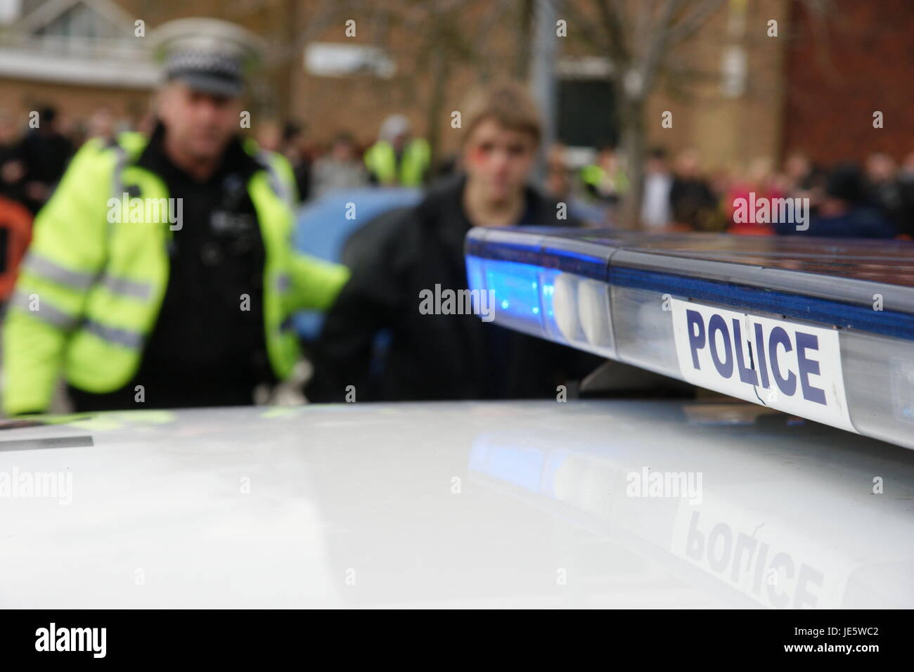 police dealing with public disorder, knife crime, teenager with knife - Stock Image