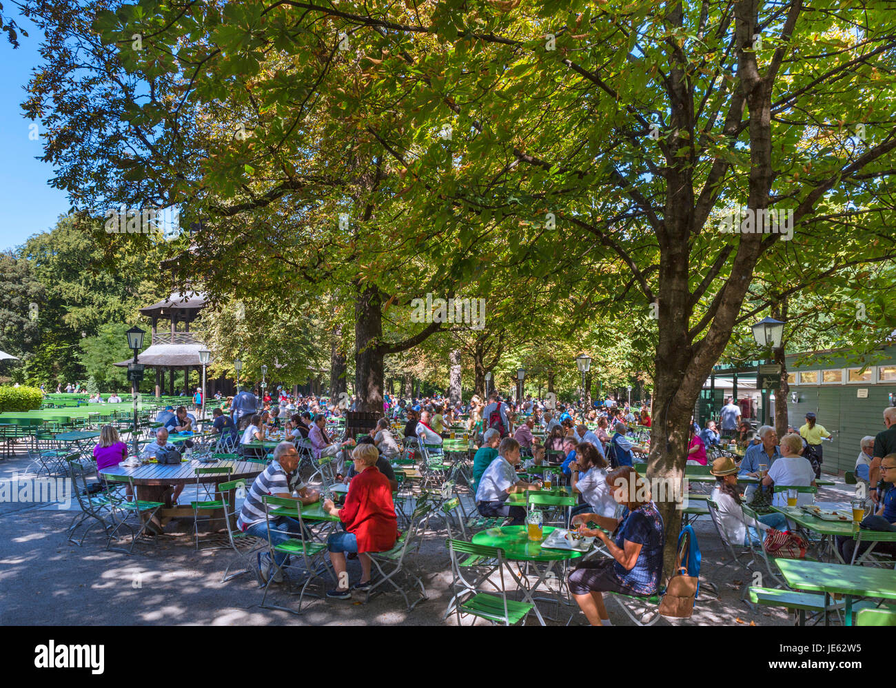 Beer Garden at the Chinesischen Turm (Chinese Tower) in the Englischer Garten, Munich, Bavaria, Germany - Stock Image