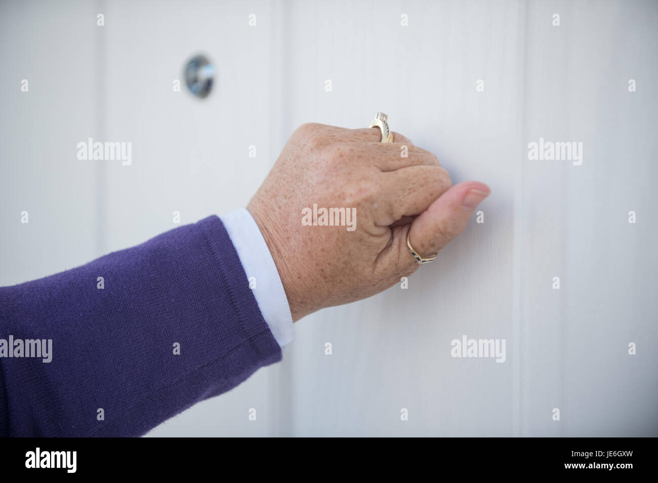Copyrighted Image by Paul Slater/PSI - Generic image of a person knocking on a front door. - Stock Image