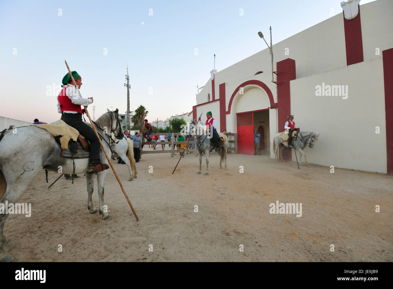 Traditional running of wild bulls by the 'campinos', during the Barrete Verde (Green Cap) festivities. Alcochete, - Stock Image
