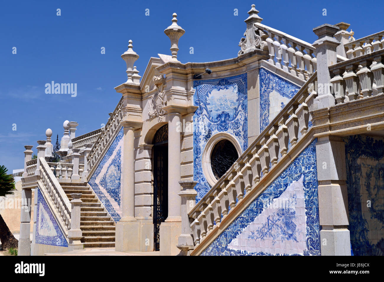 Portugal: Blue and white tiles as decoration on baroque staircase at Estoi Palace Stock Photo