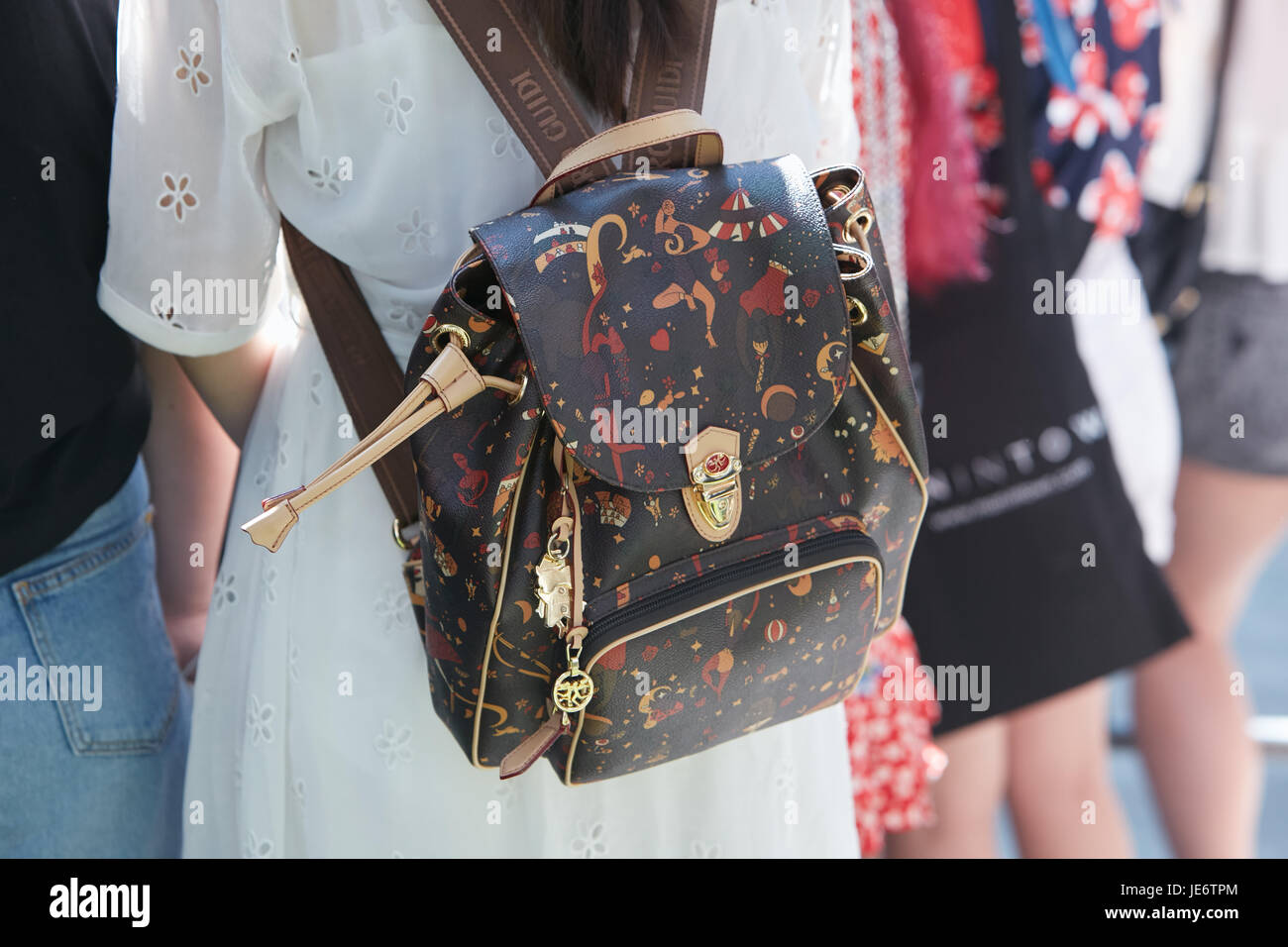 a565d5ccfc MILAN - JUNE 17: Woman with Piero Guidi backpack with human figues designs  before Emporio Armani fashion show, Milan Fashion Week street style on June