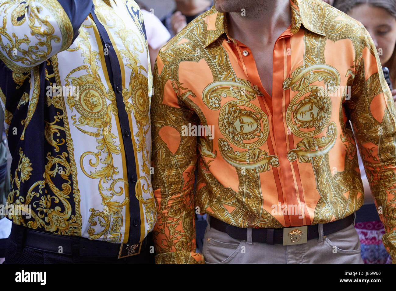 937fa2566bb2 MILAN - JUNE 17: Men with Versace decorated shirts in golden colors before Versace  fashion show, Milan Fashion Week street style on June 17, 2017 in M