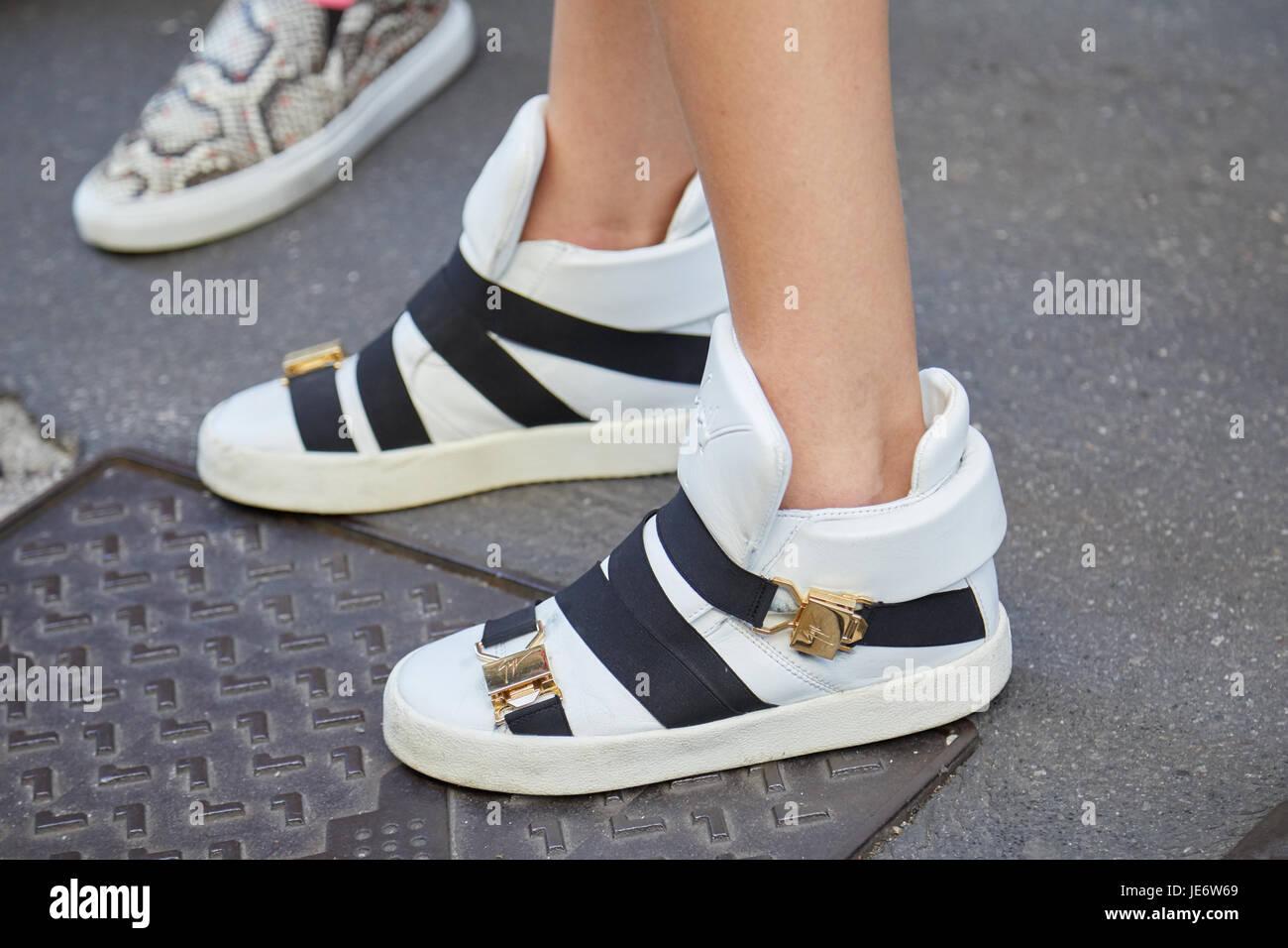 vitlök reptiler Väcka  MILAN - JUNE 17: Woman with Giuseppe Zanotti white sneakers before ...