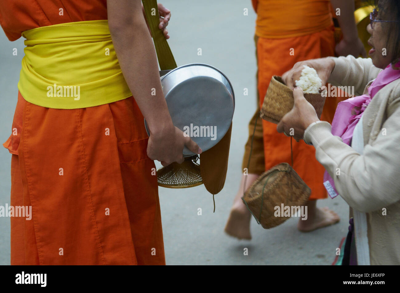Laos, province of Luang Prabang, city of Luang Prabang, Buddhist monks collect alms and rice, Stock Photo