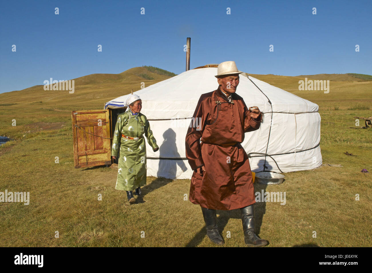 Mongolia, Central Asia, Arkhangai province, nomad in traditional clothes before her Jurte, Stock Photo
