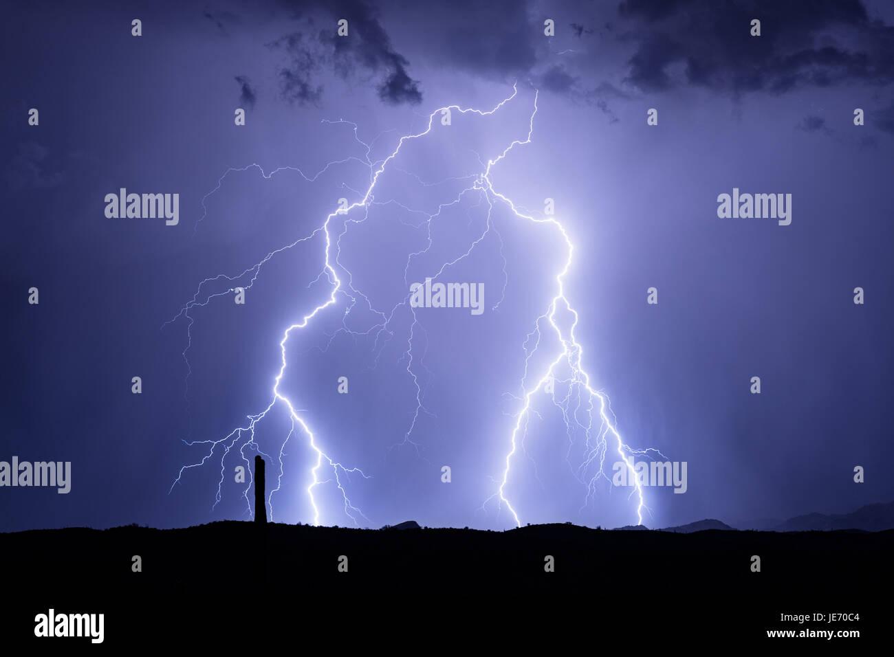 Lightning bolts flash during a summer monsoon storm Stock Photo