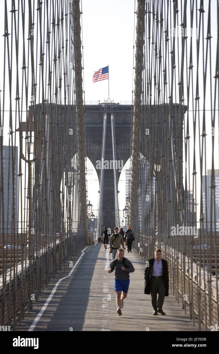 The USA, America, New York, Manhattan, jogger and pedestrian on Brooklyn Bridge, Stock Photo