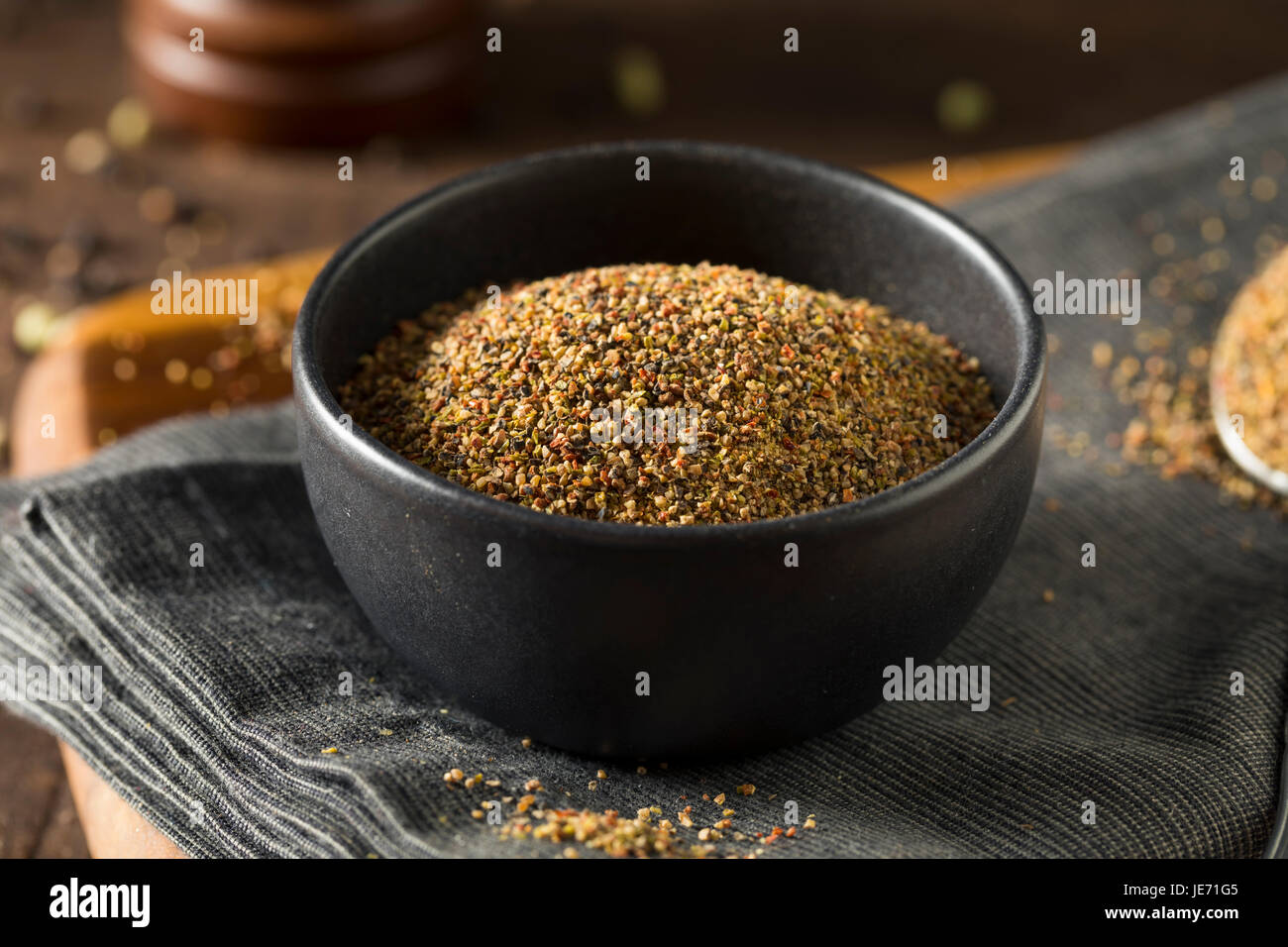 Dry Organic Mixed Ground Pepper Blend in a Bowl - Stock Image