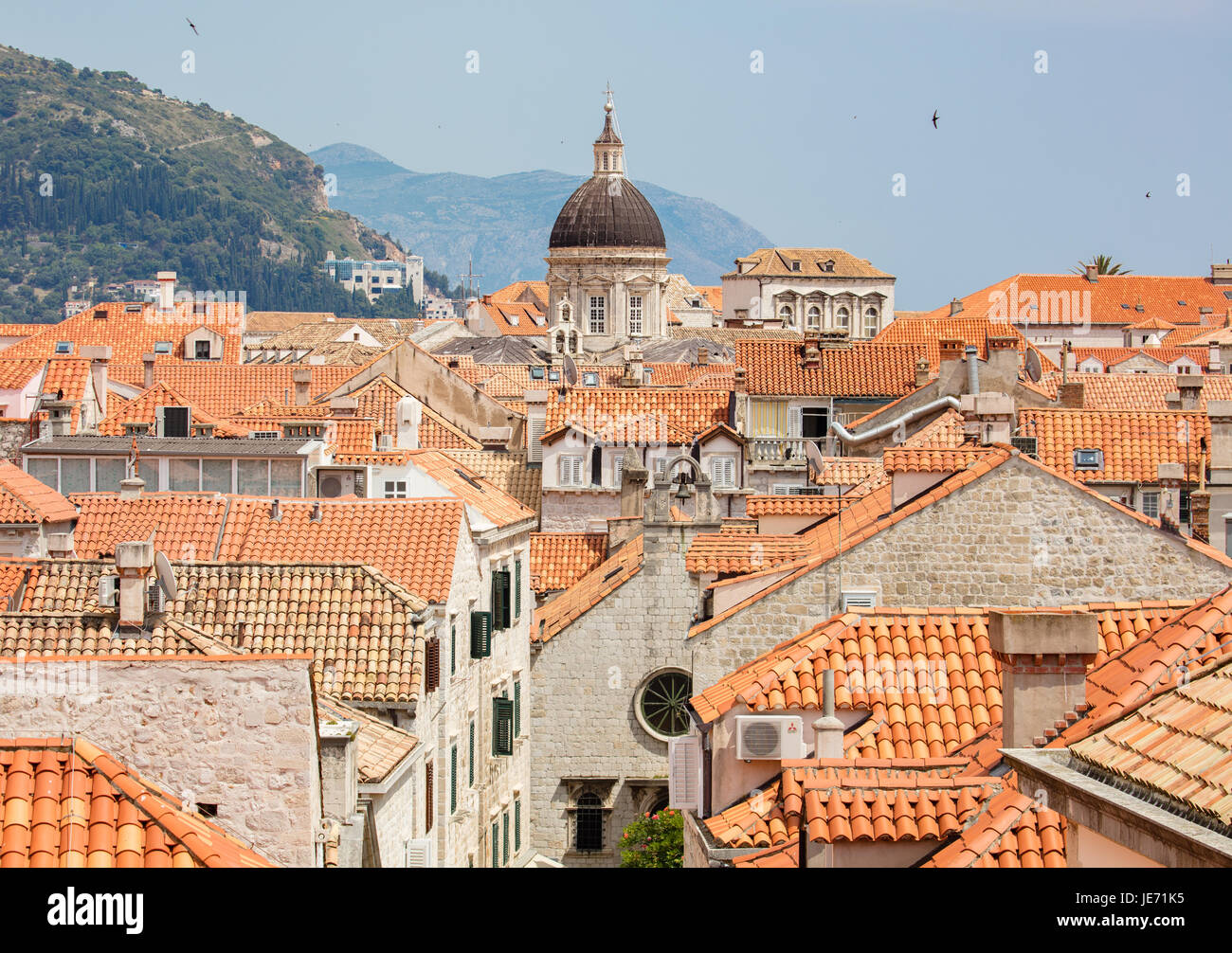 View from the massive defensive walls enclosing the beautiful red roofed medieval city of Dubrovnik on the Dalmation Stock Photo