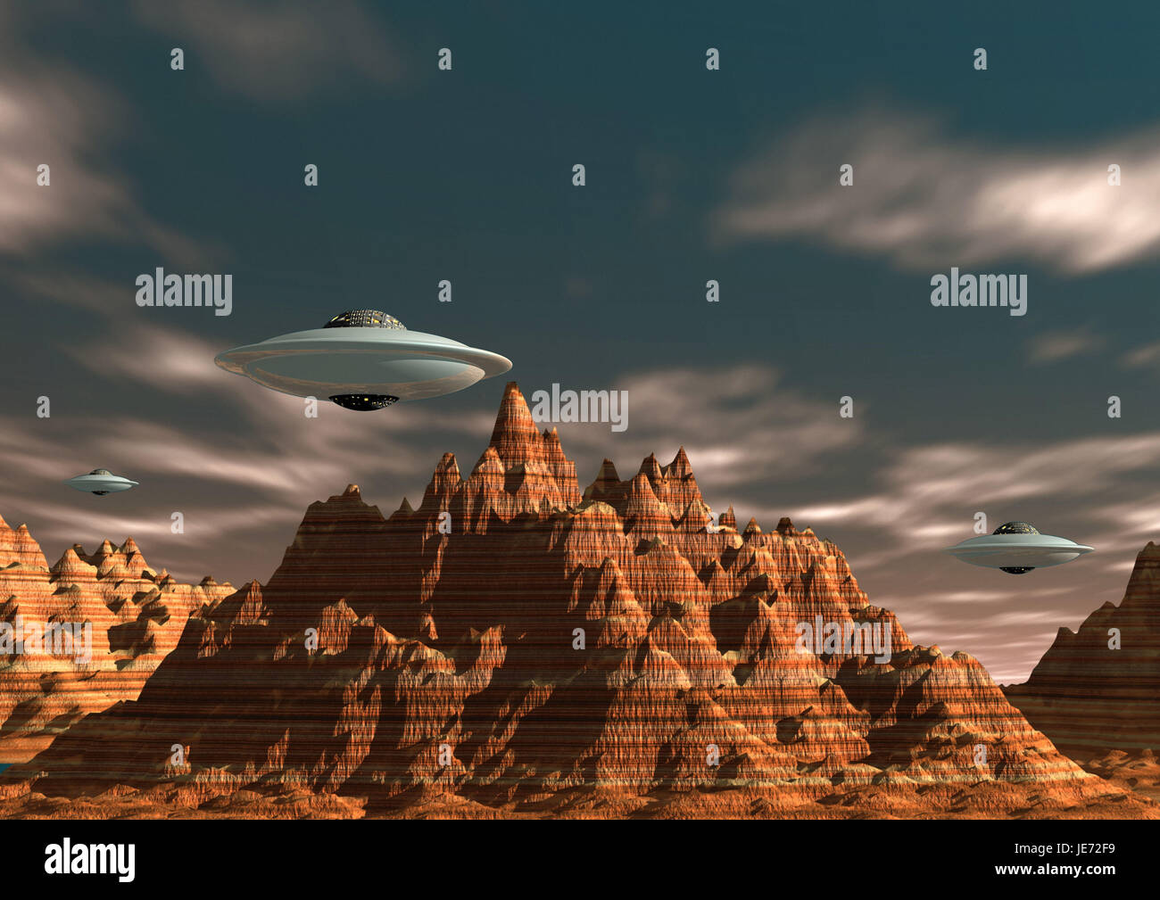 UFOs about mountain landscape, - Stock Image