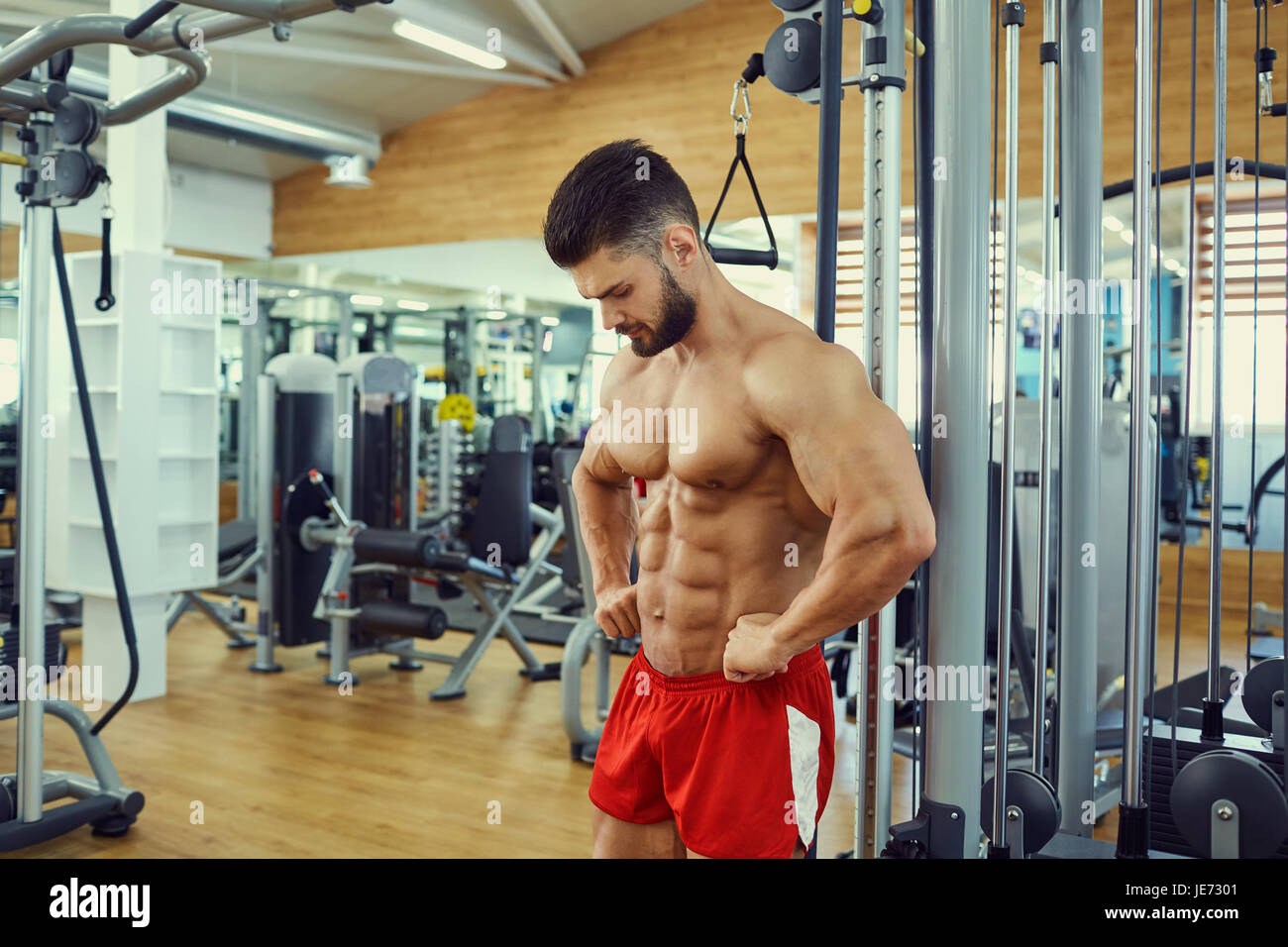 Portrait of a male bodybuilder in  gym - Stock Image