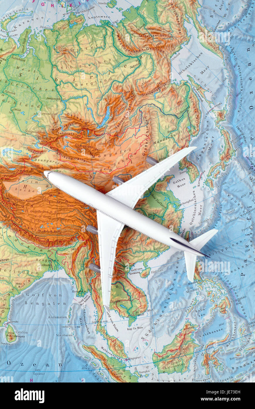 Airplane on a map of Asia, China, Japan, Korea, Stock Photo