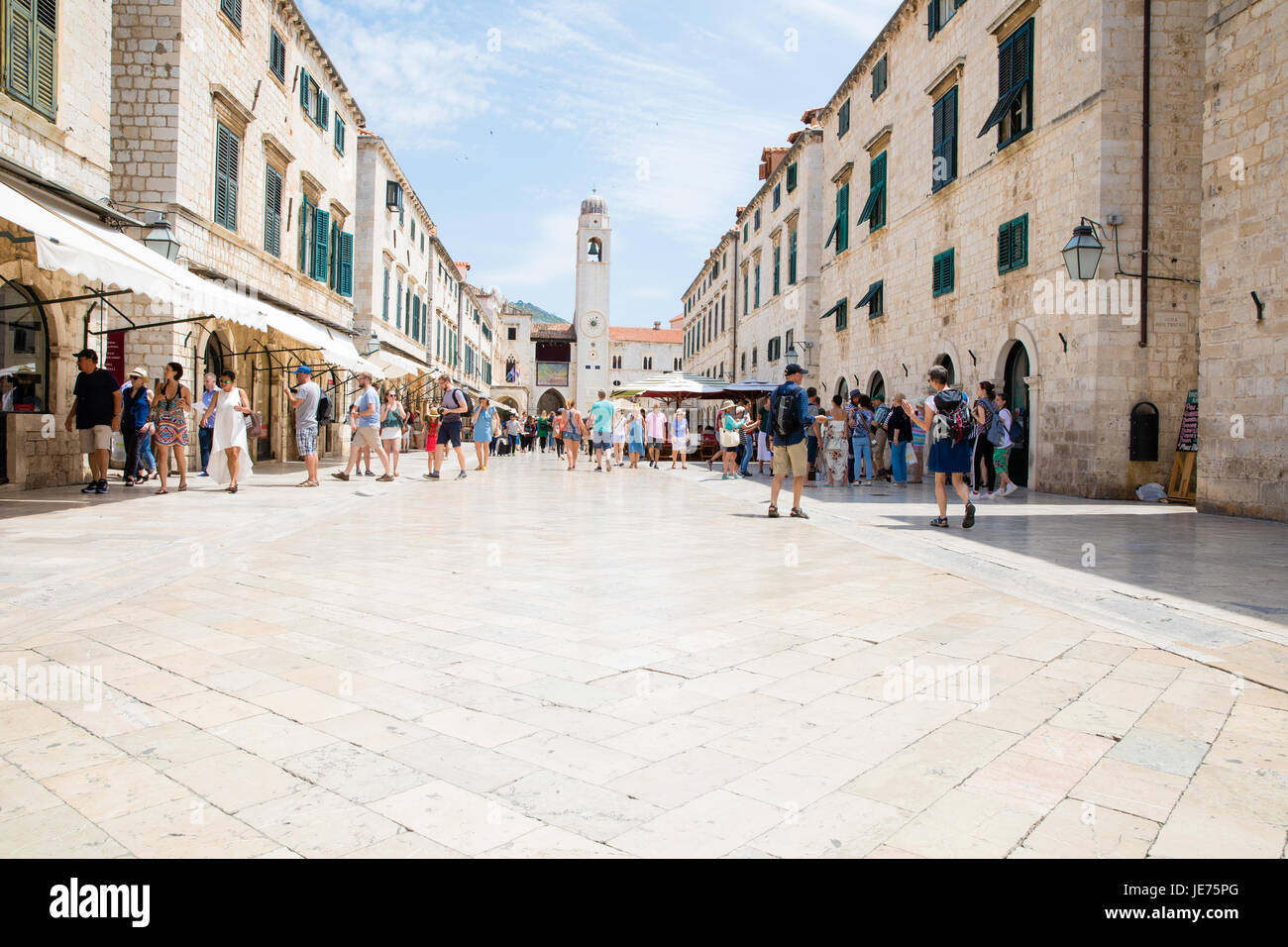 Marble paving polished by centuries of human feet on the Stradun the main street of the Old City of Dubrovnik Croatia - Stock Image