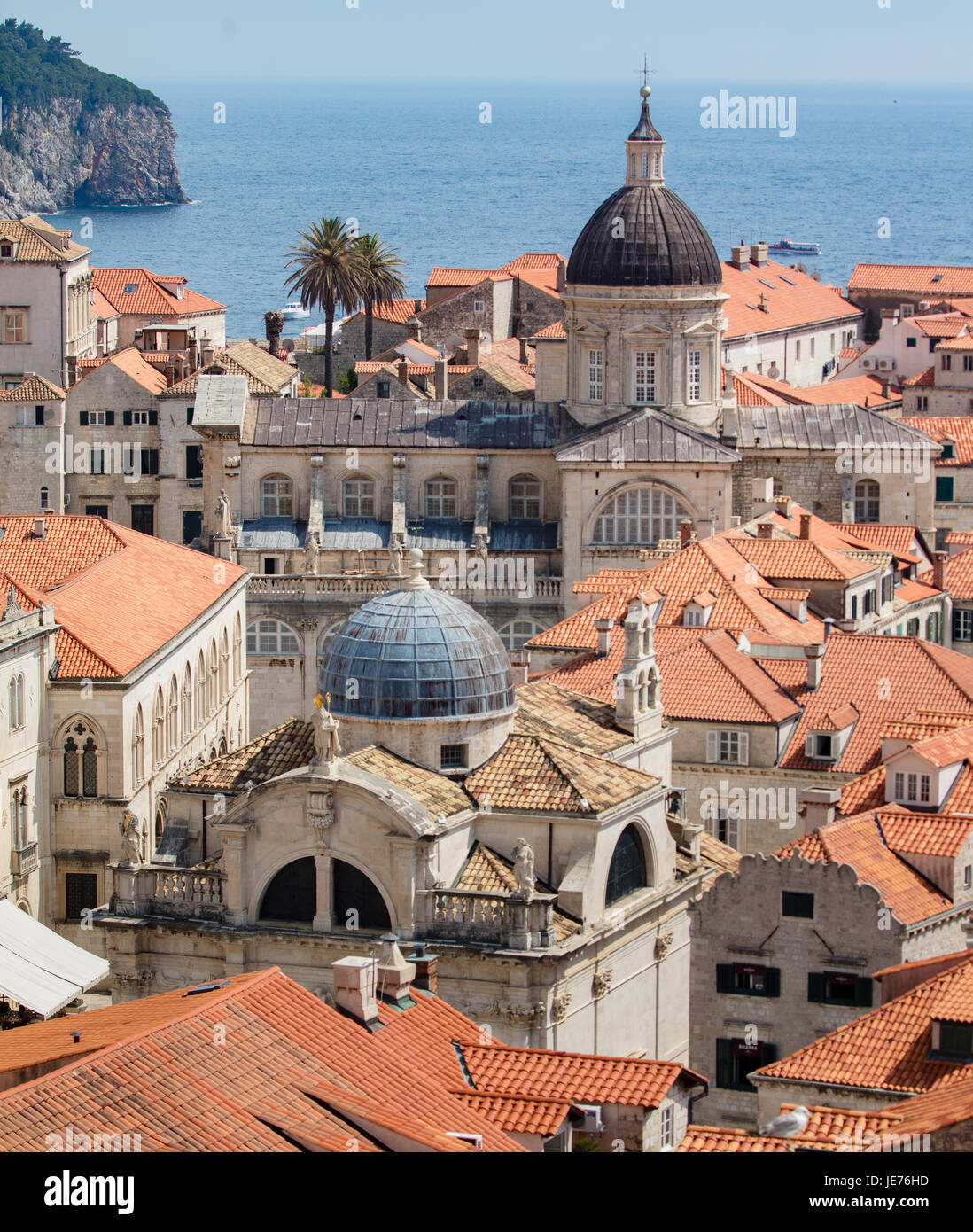 View from the massive defensive walls enclosing the beautiful red roofed medieval city of Dubrovnik on the Dalmation - Stock Image
