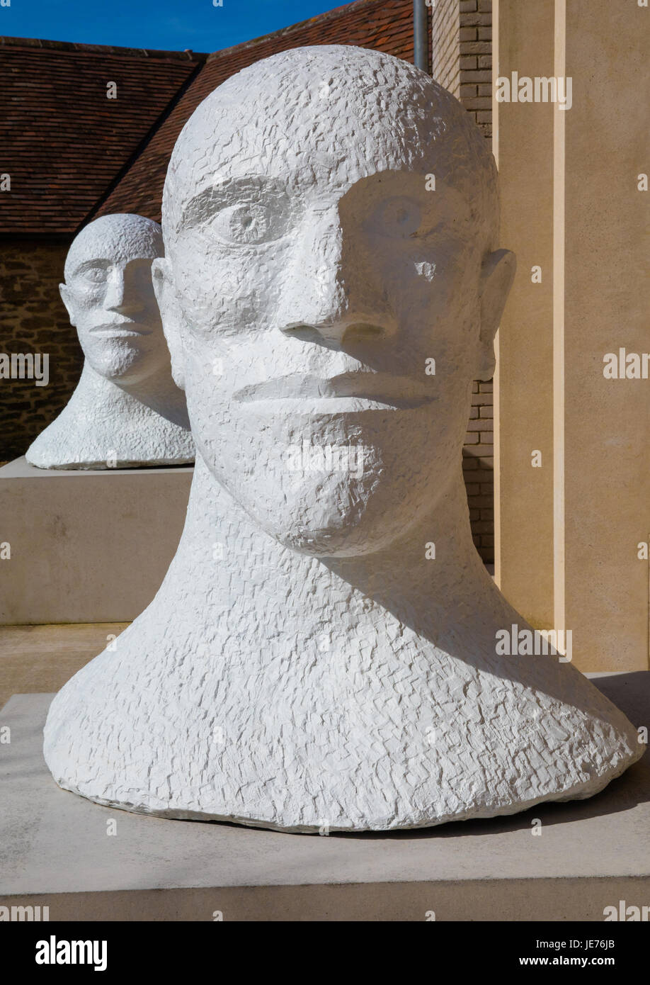 Two bronze male head sculptures in white surfaced bronze from the Desert Quartet series by sculptor Elizabeth Frink - Stock Image