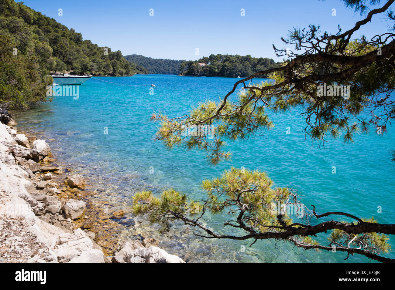 Turquoise blue waters of Malo Jezero the smaller of two inland sea lakes on the island of Mljet on the Dalmatian - Stock Image
