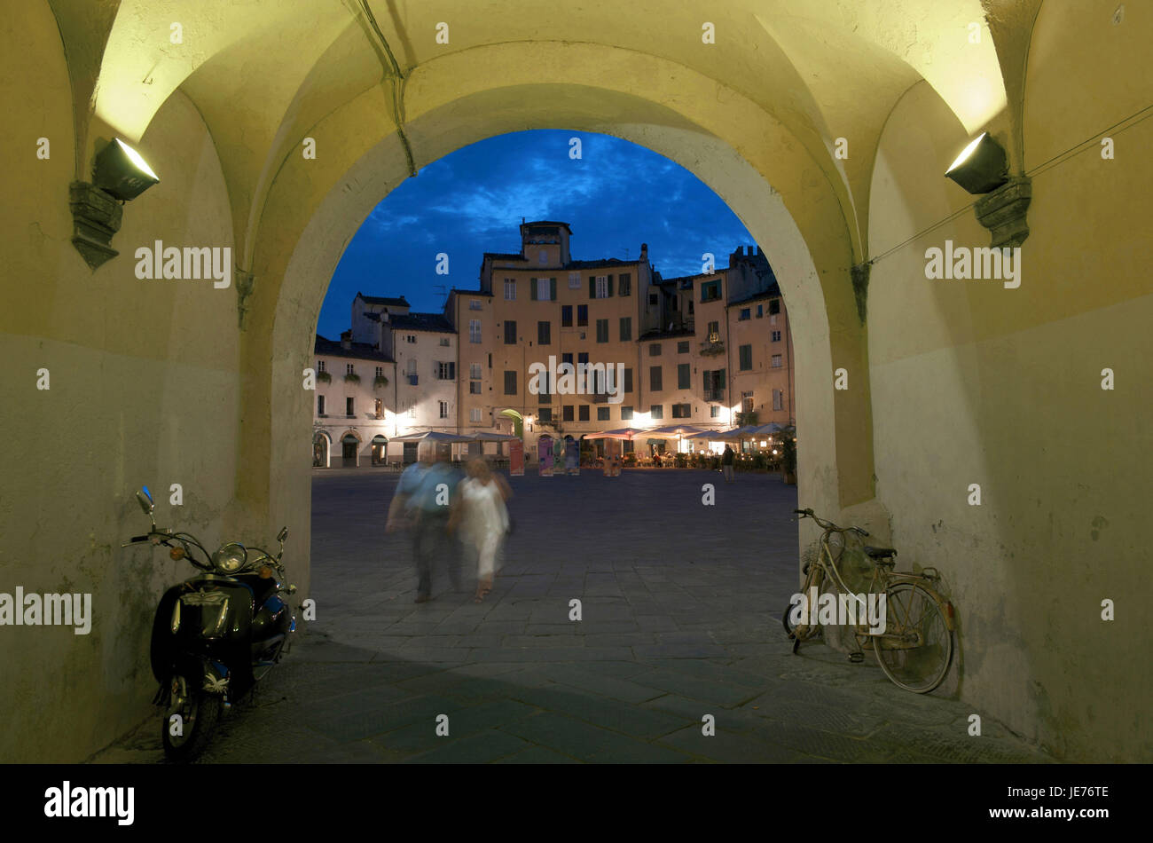 Italy, Tuscany, Lucca, Piazza del Mercato at night, view by an archway, - Stock Image