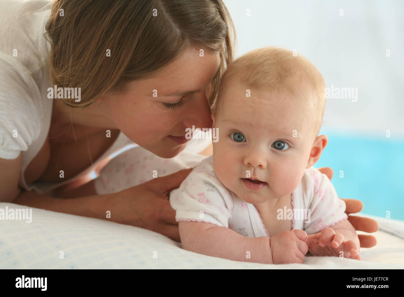 Nut, baby, 4 months, cuddle, dresses, Indoor, girl, person, woman, suture, touch, portrait, curled, happily, tenderness, - Stock Image