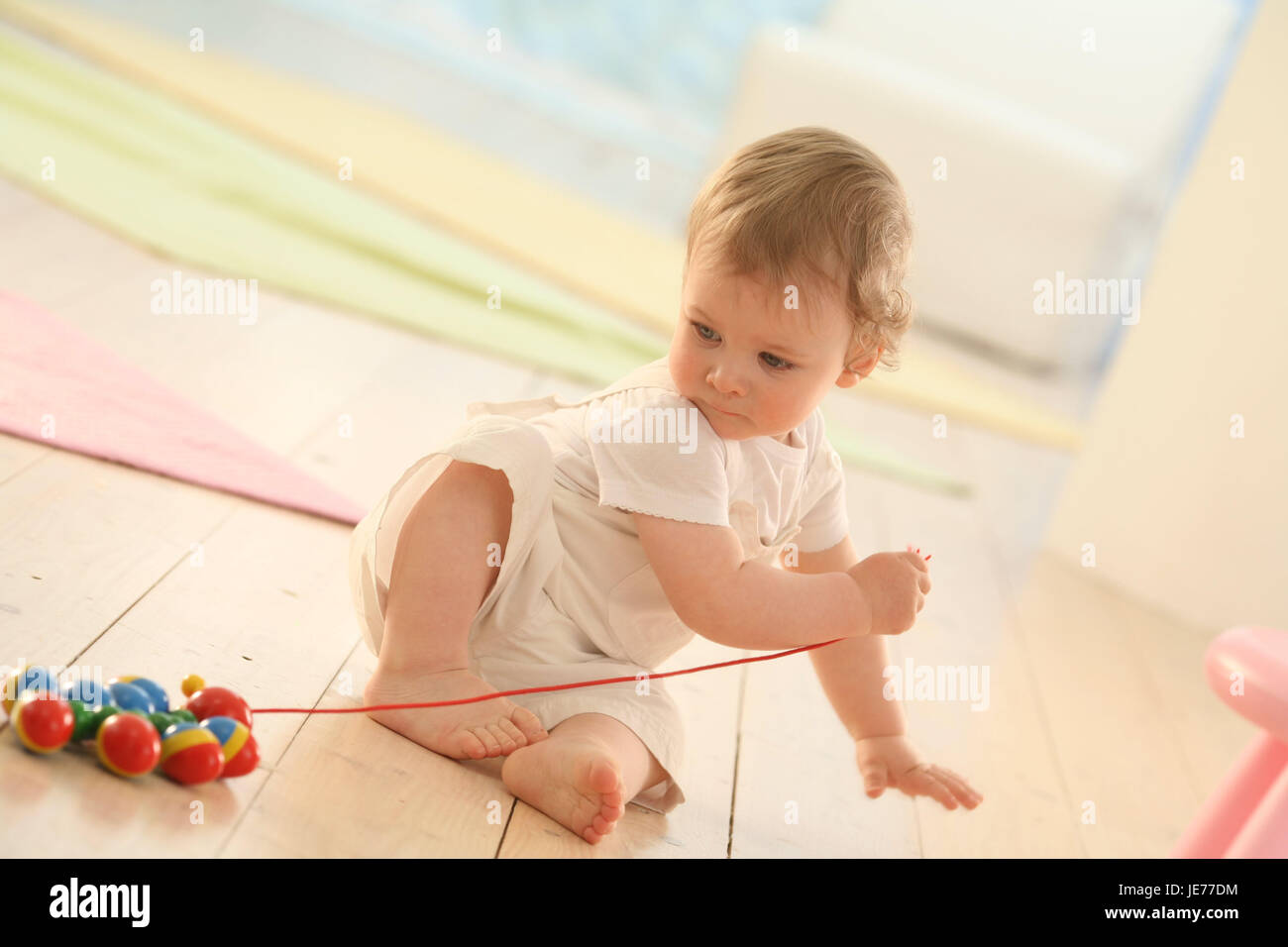Baby, 11 months, wooden toys, caterpillar, play, Nachziehtier, dresses, blond, learn, little locks, discoveries, - Stock Image